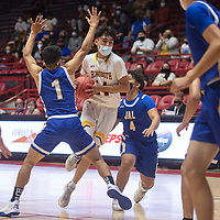 Rehoboth Lynx Talon West (14) drives to the basket as Jal Panther Jacob Lujan (1) defends in the New Mexico Class 2A boys basketball state final at The Pit in Albuquerque Friday. Rehoboth Christian defeated Jal 55-50.