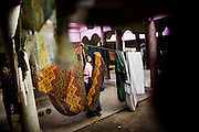 A Christian refugee woman hangs out the clothes at the YMCA relief comittee in Orissa's capital Bhubaneswar. Nov. 04, 2008...