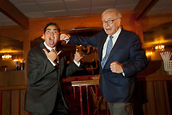 Warren Buffett poses with business students from universities around the country after at lunch at Piccolo Pete's Restaurant in Omaha, Neb., Nov. 11, 201. Here, Buffett poses with Antonio Espinoza of the University of Notre Dame.