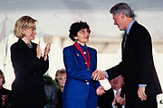 Museum director Nina M. Archabal is presented the National Humanities Medal by President Bill Clinton and First Lady Hillary Clinton during a ceremony on the South Lawn of the White House September 29, 1997 in Washington, DC.