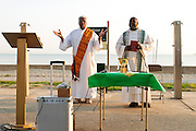 Pastor Tom Jackson O.P. (R) joins Deacon Leonard Richardson (L) to celebrate a sunrise mass at Rainbow Beach on Chicago's south side to pray for peace and non-violence during the upcoming school year. The event hosted by The Black Catholic Deacons in the Archdiocese of Chicago is one of six simultaneous masses along Chicago's lakefront. August 25, 2012 l Brian J. Morowczynski~ViaPhotos...For use in a single edition of Catholic New World Publications, Archdiocese of Chicago. Further use and/or distribution may be negotiated separately. Contact ViaPhotos at 708-602-0449 or email brian@viaphotos.com.