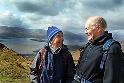 Elderly married couple exercise by walking in Loch Lomond, Scotland.MODEL RELEASED