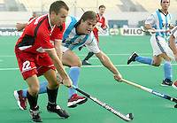 10th World Cup Fieldhockey. Germany vs Argentina 5-2. Argentina-player Maximiliano Caldas tries to stop  German Matthias Witthaus (l).