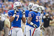 Dec 1, 2012; Tulsa, Ok, USA; Tulsa Hurricanes defensive back Lowell Rose (7) and linebacker Shawn Jackson (55) walks toward the line during a game against the University of Central Florida Knights at Skelly Field at H.A. Chapman Stadium. Tulsa defeated UCF 33-27 in overtime to win the CUSA Championship. Mandatory Credit: Beth Hall-USA TODAY Sports