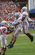 COPYRIGHT DAVID RICHARD<br /> Quarterback Troy Smith, right, greets Ted Ginn near the end zone after the two connected on a 65-yard touchdown pass yesterday in the first quarter.