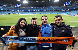 Fans hold match 'half and half' scarf before the game
