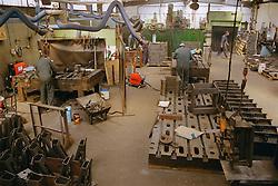 Men working at engineering works,
