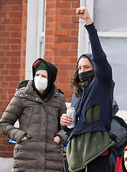 © Licensed to London News Pictures. 29/03/2021. London, UK. Evicted squatters gather near the former Cavendish Road Police Station in Clapham in south London where they had occupied the building as part of a 'Kill The Bill' protest. Murdered woman Sarah Everard walked past the building on the night she went missing on March 3, 2021. Photo credit: Ben Cawthra/LNP