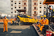 Young workers at the  workplace of a new central area in Kilamba Kiaxi, Luanda, Angola. This new citie is being constructed by a multinational chinese company by the name CITIC.