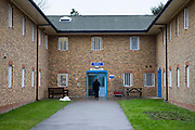 The main entrance to the residential wings. HM Prison Send is a Closed Category women's prison, located in the village of Send (near Woking), in Surrey, England. The prison is operated by Her Majesty's Prison Service. Send is a closed prison for adult females. In addition it also houses a 20 bed Addictive Treatment Unit, an 80 bed Resettlement Unit and a 40 bed Therapeutic Community. HMP Sends Education Department runs Key Skills courses and NVQs in Business Administration. The Farms and Gardens department offers Floristry NVQs, and the Works Department run an industrial workshop and painting party. Prisoners held in the Resettlement Unit can also do voluntary work, attend College courses and Work Placements in the outside community.