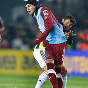 Fenerbahce's Emre BELOZOGLU (R) and Trabzonspor's Gustavo COLMAN (L) during their Turkish superleague soccer derby match Fenerbahce between Trabzonspor at the Sukru Saracaoglu stadium in Istanbul Turkey on Sunday 30 January 2011. Photo by TURKPIX