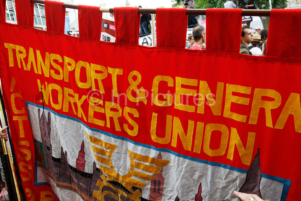 Transport and General Workers Union banner. Demonstration in Central London on a day of General Strike action by public sector workers and unions. Civil servants, teachers, health workers all came out on a day of peaceful march and protest against government cuts which look set to see their pensions change.