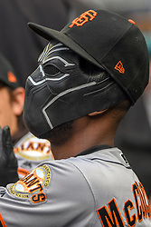 June 10, 2018 - Washington, DC, U.S. - WASHINGTON, DC - JUNE 10:  San Francisco Giants center fielder Andrew McCutchen (22) wears the Black Panther mask in the dugout prior to the start of the game between the San Francisco Giants and the Washington Nationals on June 10, 2018, at Nationals Park, in Washington D.C. The San Francisco Giants defeated the Washington Nationals, 2-0.  (Photo by Mark Goldman/Icon Sportswire) (Credit Image: © Mark Goldman/Icon SMI via ZUMA Press)
