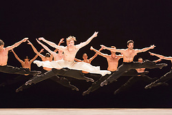 © Licensed to London News Pictures. 01/07/2014. London, England. Performance of Sehnsucht with Silas Henriksen at the front. Dress rehearsal of the works Sehnsucht (longing) and Schmetterling (butterfly) of Nederlands Dans Theater 1 at Sadler's Wells. The company presents a UK premiere of these two works from 1 to 4 July 2014.  Photo credit: Bettina Strenske/LNP