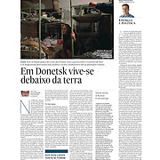 """Tearsheet of """"In Donetsk, life is underground"""" published in Expresso"""