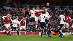 Arsenal's Shkodran Mustafi (centre) scores his side's first goal of the game during the Premier League match at the Emirates Stadium, London.