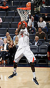 CHARLOTTESVILLE, VA- NOVEMBER 13: Assane Sene #5 of the Virginia Cavaliers shoots the ball during the game on November 13, 2011 at the John Paul Jones Arena in Charlottesville, Virginia. Virginia defeated South Carolina State 75-38. (Photo by Andrew Shurtleff/Getty Images) *** Local Caption *** Assane Sene