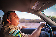 "03 MAY 2012 - VEKOL VALLEY, RURAL PINAL COUNTY, AZ:    Jon Young (CQ Jon), the BLM  Chief Ranger for Arizona, patrols on Bureau of Land Management land south of Interstate 8 and west of Casa Grande in rural Pinal County. The area has been a hotbed of illegal immigrant and drug smuggling for years. The BLM has undertaken a series of ""surges"" in the area, increasing their law enforcement patrols and partnering with Border Patrol and Pinal County Sheriff's Department officers to reduce criminal activity in the area.       PHOTO BY JACK KURTZ"