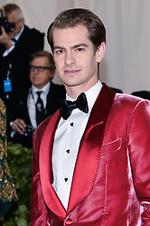 Andrew Garfield walking the red carpet at The Metropolitan Museum of Art Costume Institute Benefit celebrating the opening of Heavenly Bodies : Fashion and the Catholic Imagination held at The Metropolitan Museum of Art  in New York, NY, on May 7, 2018. (Photo by Anthony Behar/Sipa USA)