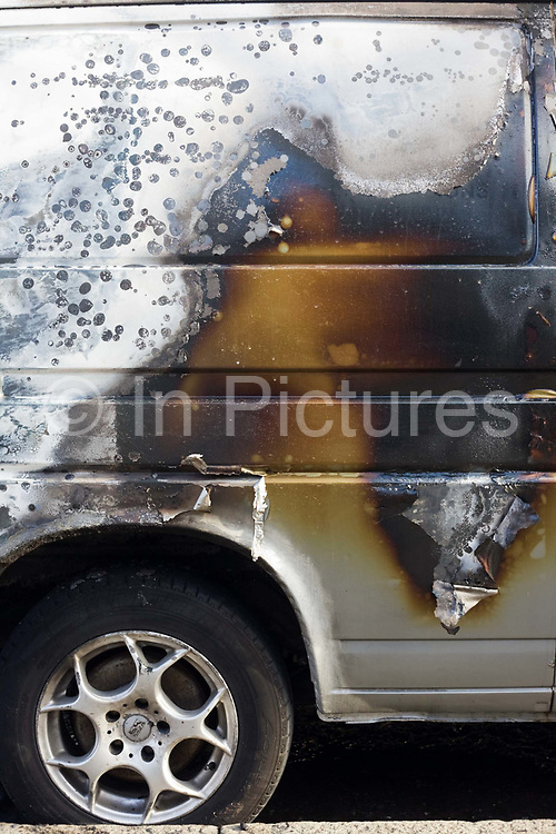 Scorched paintwork of a van after an inner-city estate fire in south London. About 310 people were forced to leave their homes after the fire engulfed a wooden structure under construction in scaffolding at Sumner Road and Garrisbrooke Estate, Peckham, London at about 0430 AM. It spread to two blocks of maisonettes and a destroyed a pub. More than 150 firefighters tackled this unusually large and ferocious fire which injured ten people, including two police officers who received hospital treatment for minor injuries.