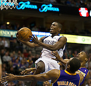 Darren Collison (4) of the Dallas Mavericks drives to the basket against the Los Angeles Lakers at the American Airlines Center in Dallas on Sunday, February 24, 2013. (Cooper Neill/The Dallas Morning News)