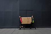 Workmen deliver a wooden box to an events venue, on 4th May 2017, in London, England.