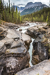 Mistaya Canyon with Mt. Sarbach towering above. Mistaya Canyon is a slot canyon in the north of Banff National Park on the Icefields Parkway.