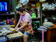 29 JANUARY 2019 - BANGKOK, THAILAND:       A woman working in her family workshop makes shrimp sausages that will be sold during Chinese New Year. Chinese New Year celebrations in Bangkok start on February 4, 2019. The coming year will be the Year of the Pig in the Chinese zodiac. About 14% of Thais are of Chinese ancestry and Lunar New Year, also called Chinese New Year or Tet is widely celebrated in Chinese communities in Thailand.     PHOTO BY JACK KURTZ