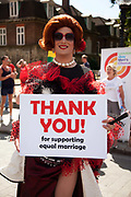 A man dressed up in drag outside Parliament ahead of the third and final reading of the 'Marriage Bill 2012-13 to 2013-14' in the House of Lords.<br /> Summary of the Marriage (Same Sex Couples) Bill 2012-13 to 2013-14<br /> A Bill to make provision for the marriage of same sex couples in England and Wales, about gender change by married persons and civil partners, about consular functions in relation to marriage, for the marriage of armed forces personnel overseas, and for connected purposes.