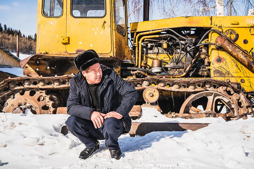 Local and tractor, Jyrgalan, Kyrgyzstan.