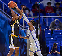 Southern Miss Golden Eagles guard LaDavius Draine (11) looks to pass as Middle Tennessee Blue Raiders guard Antonio Green (55) defends during the Southern Mississippi Golden Eagles at Middle Tennessee Blue Raiders college basketball game in Murfreesboro, Tennessee, Saturday, March, 7, 2020.<br /> Photo: Harrison McClary/All Tenn Sports