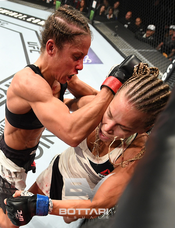NEW YORK, NY - NOVEMBER 12:  Liz Carmouche of the United States (left) fights against Katlyn Chookagian of the United States in their women's bantamweight bout during the UFC 205 event at Madison Square Garden on November 12, 2016 in New York City.  (Photo by Jeff Bottari/Zuffa LLC/Zuffa LLC via Getty Images)