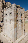 """The Ka'ba-ye Zartosht (alt: Kaba-ye Zardusht, Kaba-ye Zardosht , Persian: ???? ?????), meaning the """"Cube of Zoroaster,"""" is a 5th century B.C.E. Achaemenid-era tower-like construction at Naqsh-e Rustam, an archaeological site just northwest of Persepolis, Iran. This enigmatic structure is one of many surviving examples of the achaemenid architectural design."""