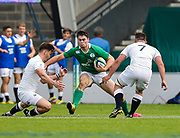 Ireland centre Conor O'Brien breaks between England flanker Will Evans and centre  Johnny Williams during the World Rugby U20 Championship Final   match England U20 -V- Ireland U20 at The AJ Bell Stadium, Salford, Greater Manchester, England onSaturday, June 25, 2016. (Steve Flynn/Image of Sport)