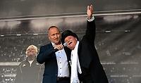 """Fotball Tippeligaen Rosenborg - Sarpsborg 08<br /> 24 august 2014<br /> Lerkendal Stadion, Trondheim<br /> <br /> <br /> Trompetist Kai Robert Johansen (H) spilte da """"Nils Arnes Plass"""" ble åpnet før kampstart. Til venstre : Gøran Sørloth<br /> <br /> <br /> Foto : Arve Johnsen, Digitalsport"""