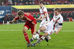 06.11.2011, SGL Arena, Augsburg, GER, 1.FBL, FC Augsburg vs. FC Bayern Muenchen, im Bild Thomas Mueller (Bayern #25) wircd von Jan-Ingwer Callsen-Bracker (Augsburg #18) gefoult // during the match  FC Augsburg vs. FC Bayern Muenchen , on 2011/11/06, SGL Arena, Augsburg, Germany, EXPA Pictures © 2011, PhotoCredit: EXPA/ nph/  Straubmeier       ****** out of GER / CRO  / BEL ******