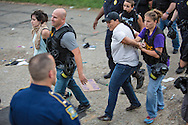 Cherri Foytlin being taken away by the police in Baton Rouge, LA at a protest today, following a rally/march against police brutality following the killing of Alton Sterling by the police on Tuesday. Cherri Foytlin is a mother and an environmental activist.. Cherri Foytlin is the head of Bold Louisiana. She is expected to be bounded out in the morning. Over forty people were arrested.