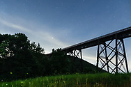 Firefies in the field and stars in the sky above the Moodna Viaduct railroad trestle in the Town of Cornwall, N.Y., on July 18, 2020.