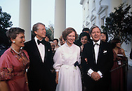 The Carters and Helmut Schmidt at greeting on the North Portico of the White House for heads of state for a NATO Dinner on May 30, 1978<br /> Photo by Dennis Brack