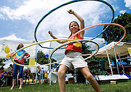 Meggie Kurtz, 8, uses the hula hoops at Scoville Park in Oak Park, IL., during Day in Our Village..