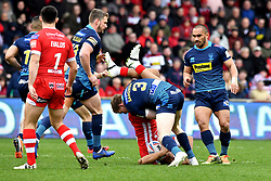 Salford Red Devils' Derrell Olpherts is tackled by Salford Red Devils' Kris Welham during the Betfred Super League match at the AJ Bell Stadium, Salford.