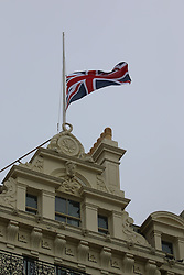 © Licensed to London News Pictures. 21/10/2014. Brighton, UK. The Grand hotel in Brighton, 30 years to the day of the attempted assassination of Margaret Tatcher when a bomb placed by the IRA exploded in the Hotel. The flag above the hotel flies at half mast to remember those who died on the that day 30 years ago. Photo credit : Hugo Michiels/LNP