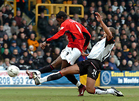 Picture: Henry Browne.<br /> Date: 28/02/2004.<br /> Fulham v Manchester United FA Barclaycard Premiership.<br /> <br /> Louis Saha scores for United despite Alain Goma's efforts.<br /> <br /> NORWAY ONLY