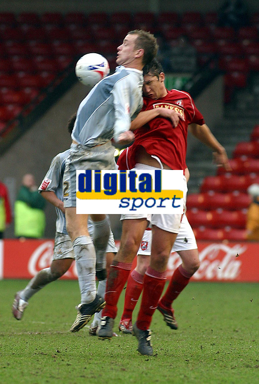 Photo: Dave Linney.<br />Walsall v Bradford City. Coca Cola League 1. 25/03/2006<br />Walsall's Ian Roper(R) keeps the pressure on  Darren Holloway.
