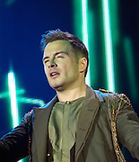 """Westlife Farewell Tour 2012 at the SECC.27-05-12...Shane Filan of Irish Super Group Westlife perform during their sell out show at the SECC in the Scottish Leg of their Farewell World Tour. ..Westlife are an Irish boy band formed in 1998. They are to disband in 2012 after their farewell tour. The group's line-up was Shane Filan, Mark Feehily, Kian Egan, and Nicky Byrne. Brian McFadden was part of the group until 2004. Westlife have sold over 45 million records worldwide which includes studio albums, singles, video release, and compilation albums.. Despite the group's worldwide success, they only have one hit single in the United States, """"Swear It Again"""", which peaked in 2000 on the Billboard Hot 100 at number 20. The band were originally signed by Simon Cowell and are managed by Louis Walsh. The group have accumulated 14 number-one singles in the United Kingdom, the third-highest in UK history, tying with Cliff Richard..The group had also broken a few records, including """"Music artist with most consecutive number 1's in the UK"""", which consists of their first seven singles and only behind The Beatles and Elvis Presley..The band have 14 UK number ones and 25 top ten singles, consisting of 20.2 million records and videos in the UK across their 14-year career - 6.8 million singles, 11.9 million albums and 1.5 million videos. The Band are best known for amazing songs such as Flying Without Wings and Safe....At The SECC, Glasgow..Picture  Mark Davison/ ProLens PhotoAgency/ PLPA.Sunday 27th May 2012."""