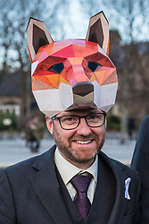 Edinburgh, Scotland, United Kingdom. 7 December, 2017. Scottish Green MSP Alison Johnston joined with animal welfare campaigners at the Scottish Parliament at Holyrood to support her member's bill to ban fox hunting in Scotland. Leader of Scottish Green Party Patrick Harvie wears a fox head mask.