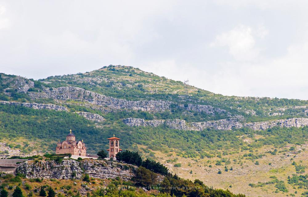 the monastery Gracanica on the historic hill known as Crkvina against a mountain backdrop. Trebinje. Republika Srpska. Bosnia Herzegovina, Europe.
