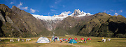 Camp 4 at 3700 meters elevation in Jancapampa Valley is under 6000-meter peaks of Nevados Pucajirca. Day 4 of 10 days around Alpamayo in Huascaran National Park (UNESCO World Heritage Site), Cordillera Blanca, Andes Mountains, Peru, South America. This panorama was stitched from 4 overlapping photos.