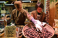 """Chestnuts at Nishiki Market - the narrow shopping street made up of more than one hundred vendors.  Various kinds of fresh foods including many Kyoto specialties such as pickles and Japanese sweets, as well as fresh seafood and vegetables are sold.  Known as """"Kyoto's Kitchen"""" Nishiki Market's history goes back several centuries and many stores have been operated by the same families for generations."""
