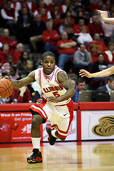 """12 January 2008: Keith """"Boo"""" Richardson charges from right to left along the baseline during a game in which  the Purple Aces of the University of Evansville lost to  the Redbirds of Illinois State on Doug Collins Court at Redbird Arena in Normal Illinois by a score of 74-66."""